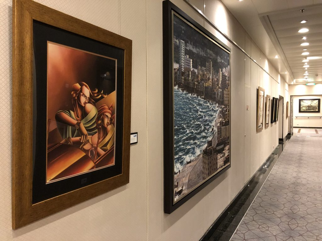 A hallway onboard Oceania Marina with it's wall displaying some of the four million dollar art collection