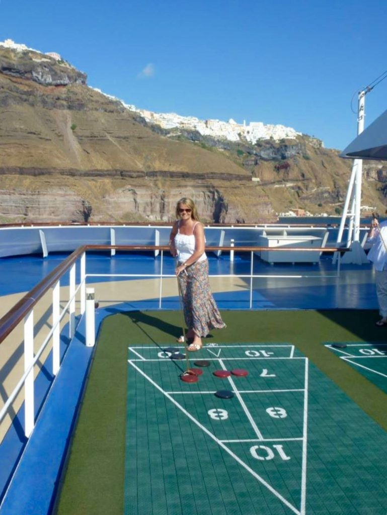 Shuffleboard on Oceania Rivera departing Santorini