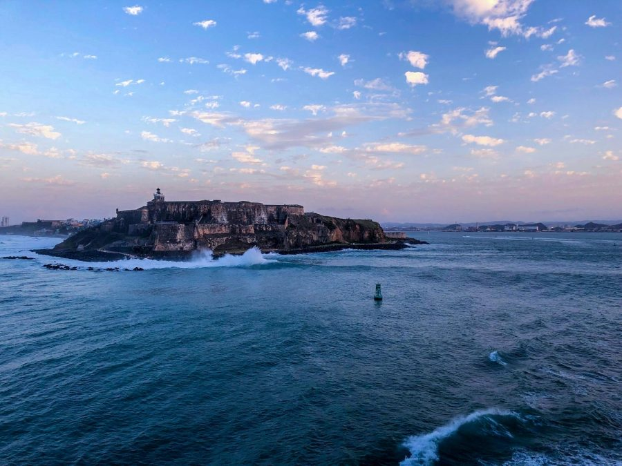 Sunset and waves crashing against Castillo San Felipe del Morro