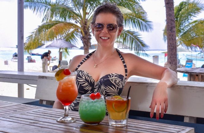 Flavia Gray Cruise Blogger sitting in Coast Beach Bar in Barbados