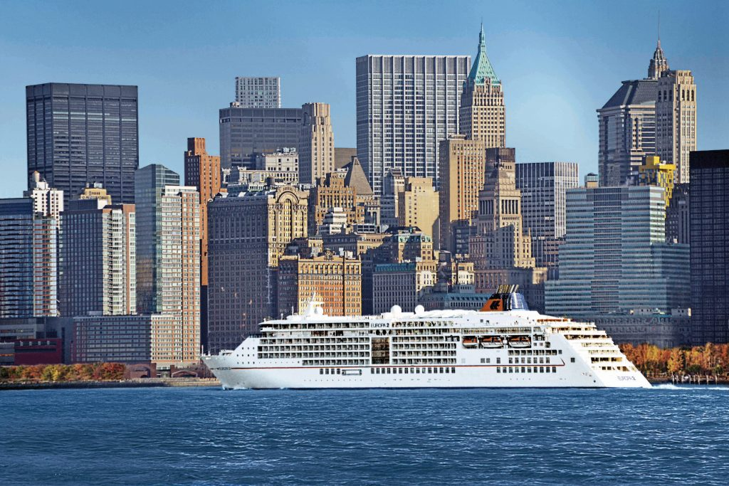 Europa 2 sailing past the New York skyline