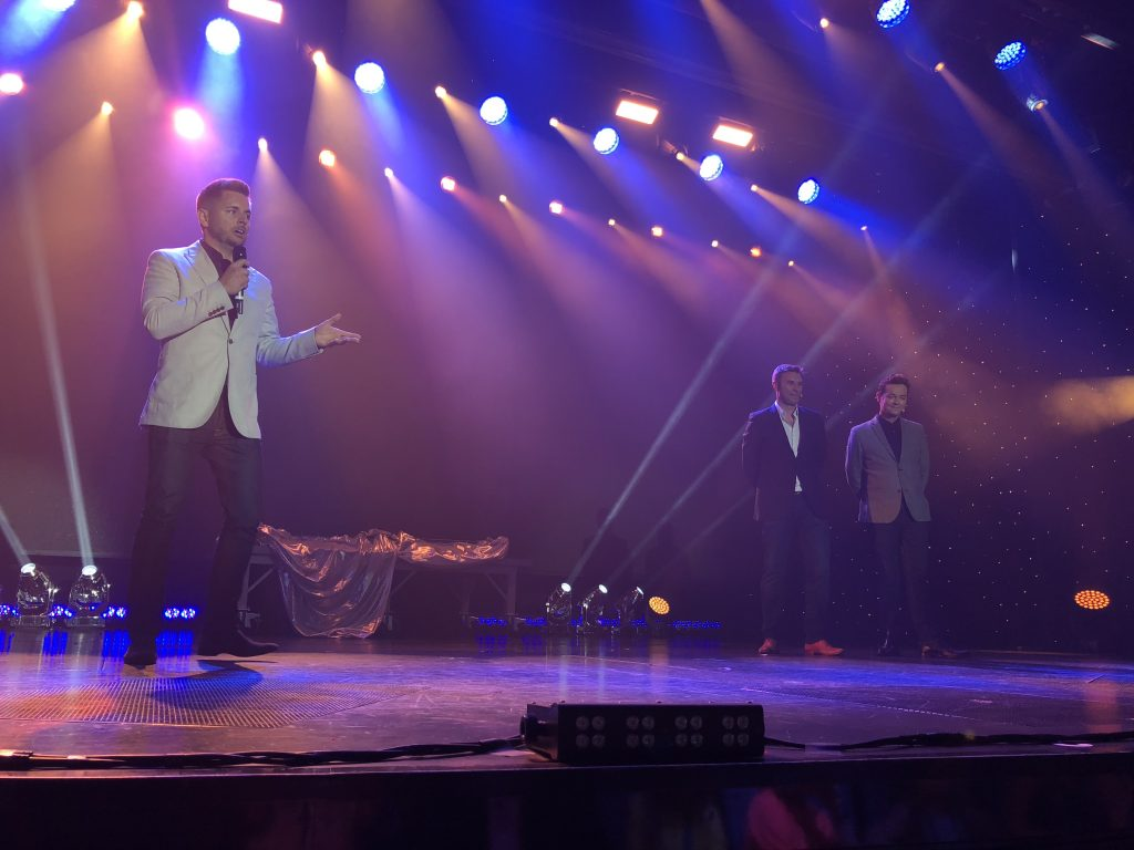 P & O Cruises Senior Vice President, Paul Ludlow onstage with Stephen Mulhurn and Jonathan Wilkes