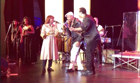 Folami, Leee John and Jerry Barnes performing Good Times on stage onboard MSC Bellissima