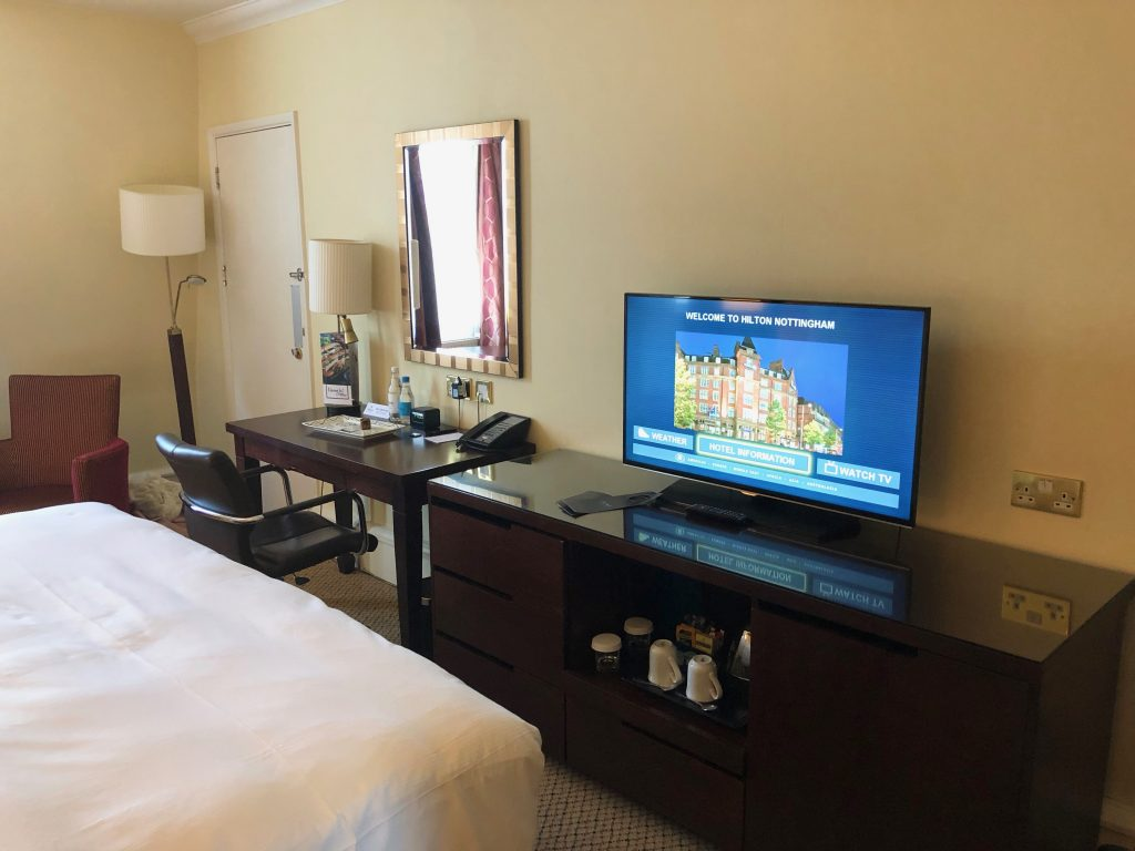 Flat screen tv, desk and vanity area in king size deluxe room at the Hilton Hotel Nottingham