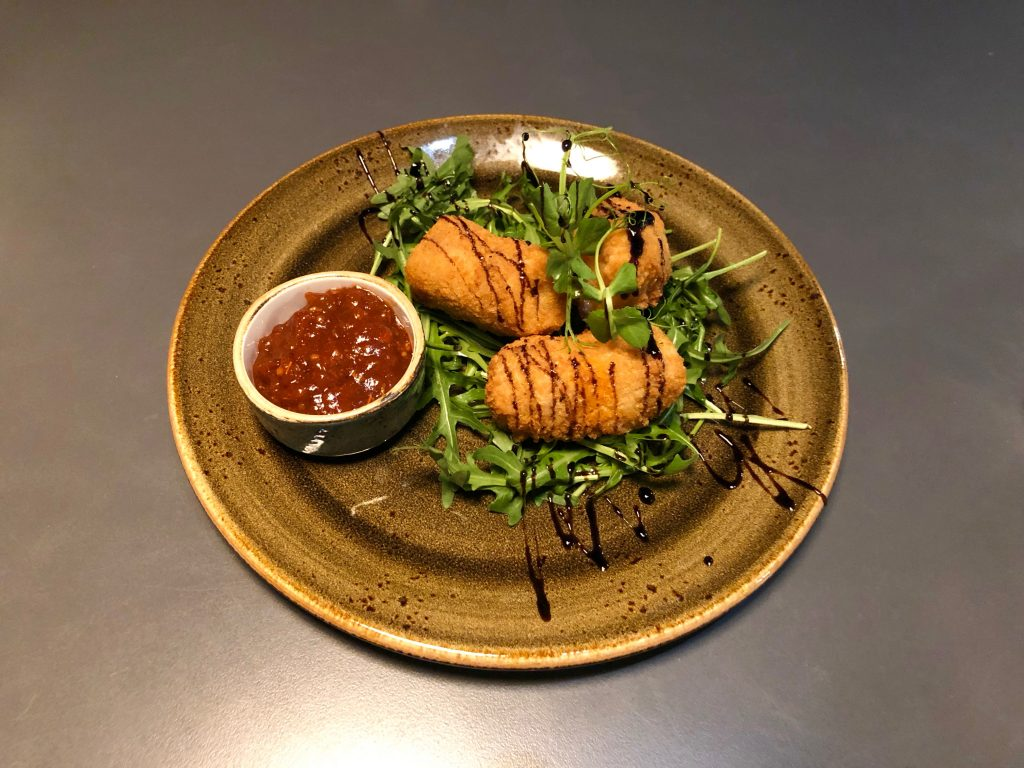 Cod and Chorizo Croquettes served on a bed of rocket with a tomato dip