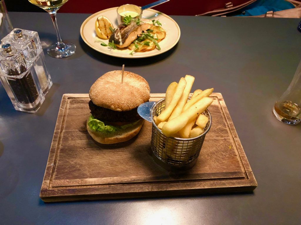 A burger and chips and salmon fillet from Bric at the Hilton Hotel Nottingham